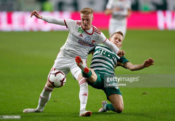 Kevin Varga of DVSC fights for the ball with Ivan Petryak of Ferencvarosi TC during the Hungarian OTP Bank Liga match between Ferencvarosi TC and...