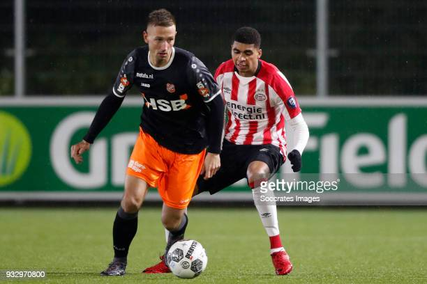 Kevin Visser of FC Volendam Laros Duarte of PSV U23 during the Dutch Jupiler League match between PSV U23 v FC Volendam at the De Herdgang on March...