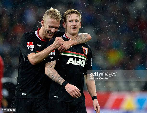 Kevin Vogt and Andre Hahn of Augsburg celebrate a goal shot by Hahn during the Bundesliga match between SC Freiburg and FC Augsburg at Mage Solar...