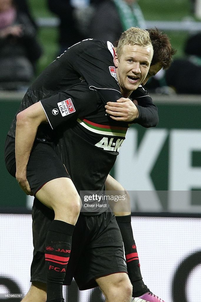 Kevin Vogt (C) and Dong Won Ji of Augsburg celebrate after the Bundesliga match between SV Werder Bremen and FC Augsburg at Weser Stadium on March 2, 2013 in Bremen, Germany.