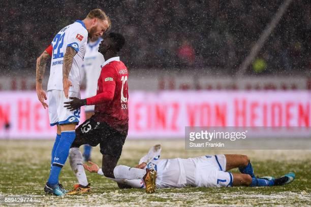 Kevin Vogt of 1899 Hoffenheim and Ihlas Bebou of Hannover 96 argue during the Bundesliga match between Hannover 96 and TSG 1899 Hoffenheim at...