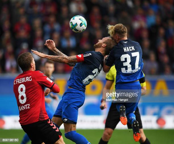 Kevin Vogt of 1899 Hoffenheim collides with Robin Hack of 1899 Hoffenheim during the Bundesliga match between SportClub Freiburg and TSG 1899...