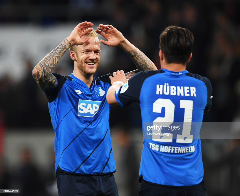 Kevin Vogt of 1899 Hoffenheim congratulates Benjamin Huebner after victory in the Bundesliga match between TSG 1899 Hoffenheim and Bayern Muenchen at Wirsol Rhein-Neckar-Arena on April 4, 2017 in Sinsheim, Germany.