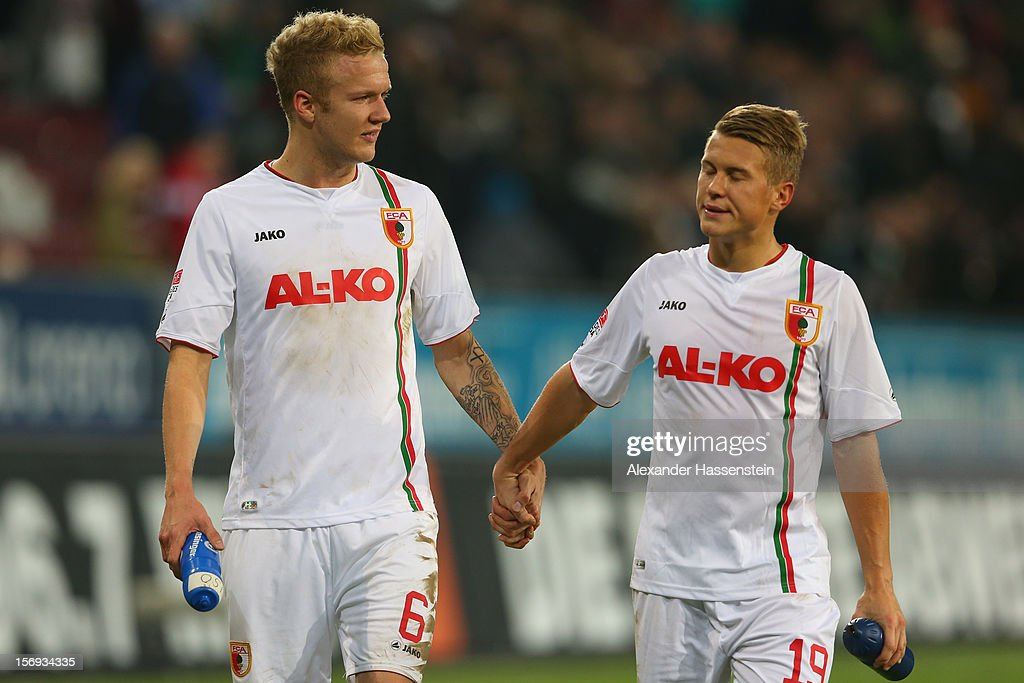 Kevin Vogt (L) of Augsburg reacts with his team mate Matthias Ostrzolek after the Bundesliga match between FC Augsburg and VfL Borussia Moenchengladbach at SGL Arena on November 25, 2012 in Augsburg, Germany.