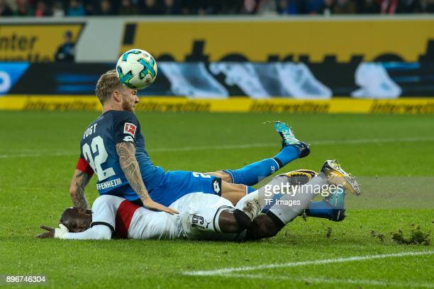 Kevin Vogt of Hoffenheim and Chadrac Akolo of Stuttgart battle for the ball during the Bundesliga match between TSG 1899 Hoffenheim and VfB Stuttgart...