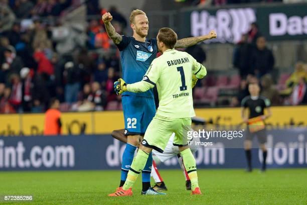 Kevin Vogt of Hoffenheim and Goalkeeper Oliver Baumann of Hoffenheim celebrate during the Bundesliga match between 1 FC Koeln and TSG 1899 Hoffenheim...