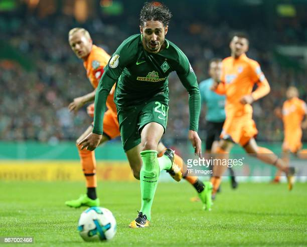 Kevin Vogt of Hoffenheim and Ishak Belfodil of Bremen battle for the ball during the DFB Cup match between Werder Bremen and 1899 Hoffenheim at...