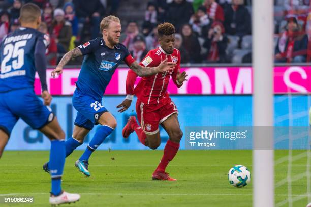 Kevin Vogt of Hoffenheim and Kingsley Coman of Bayern Muenchen battle for the ball during the Bundesliga match between FC Bayern Muenchen and TSG...