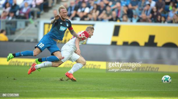 Kevin Vogt of Hoffenheim and Martin Hinteregger of Augsburg battle for the ball during the Bundesliga match between TSG 1899 Hoffenheim and FC...