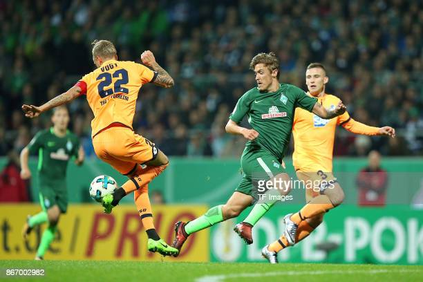 Kevin Vogt of Hoffenheim and Max Kruse of Bremen and Pavel Kaderabek of Hoffenheim battle for the ball during the DFB Cup match between Werder Bremen...