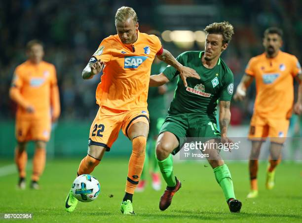 Kevin Vogt of Hoffenheim and Max Kruse of Bremen battle for the ball during the DFB Cup match between Werder Bremen and 1899 Hoffenheim at...