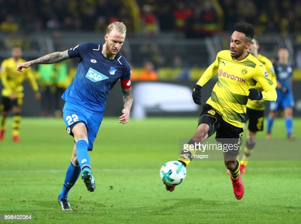 Kevin Vogt of Hoffenheim and PierreEmerick Aubameyang of Dortmund battle for the ball during the Bundesliga match between Borussia Dortmund and TSG...