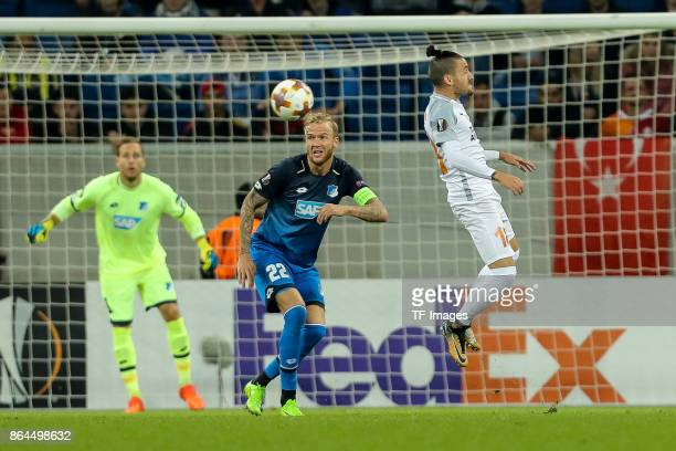 Kevin Vogt of Hoffenheim and Stefano Napoleoni of Istanbul Basaksehir battle for the ball during the UEFA Europa League Group C match between 1899...