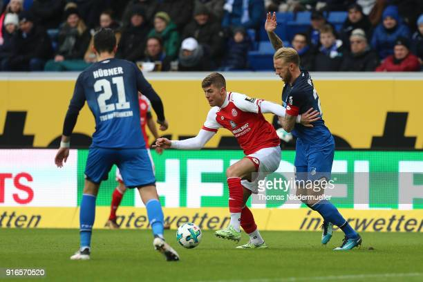 Kevin Vogt of Hoffenheim fights for the ball with Emil Berggreen of Mainz during the Bundesliga match between TSG 1899 Hoffenheim and 1 FSV Mainz 05...