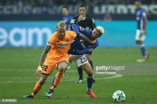Kevin Vogt of Hoffenheim fights for then all with Amine Harit of Schalke during the Bundesliga match between FC Schalke 04 and TSG 1899 Hoffenheim at...