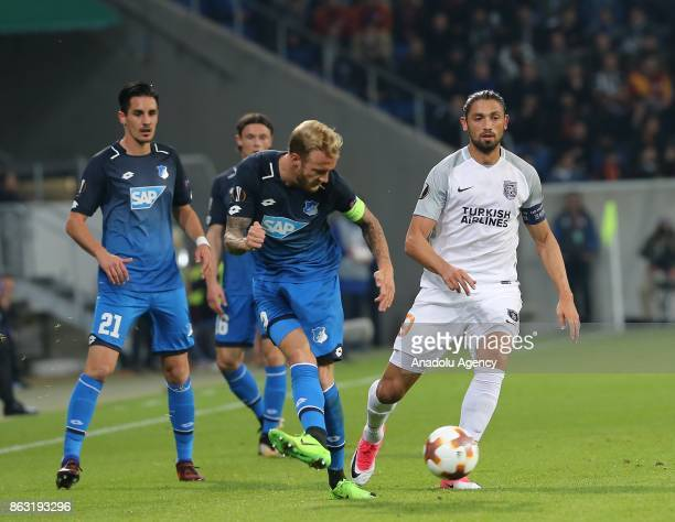 Kevin Vogt of Hoffenheim in action against Mehmet Batdal of Medipol Basaksehir during the UEFA Europa League Group C soccer match between Hoffenheim...
