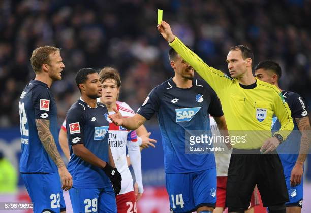 Kevin Vogt of Hoffenheim is shown the yellow card by referee Bastian Dankert during the Bundesliga match between Hamburger SV and TSG 1899 Hoffenheim...