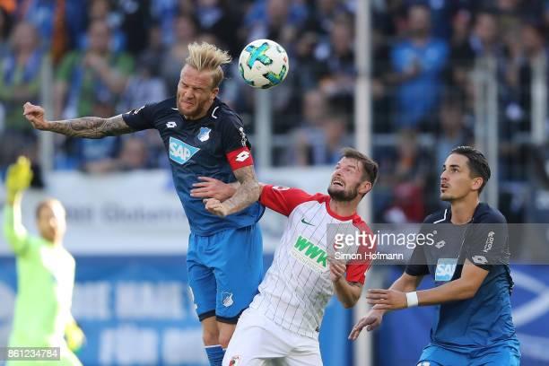 Kevin Vogt of Hoffenheim Marcel Heller of Augsburg and Benjamin Huebner of Hoffenheim during the Bundesliga match between TSG 1899 Hoffenheim and FC...