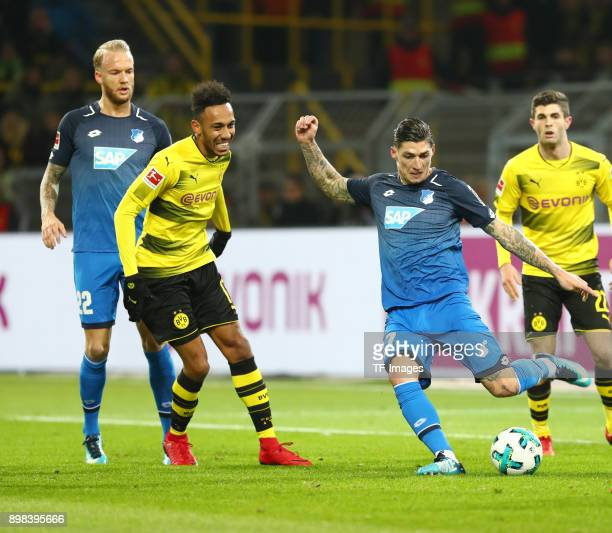 Kevin Vogt of Hoffenheim PierreEmerick Aubameyang of Dortmund and Steven Zuber of Hoffenheim battle for the ball during the Bundesliga match between...