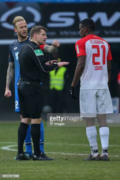 Kevin Vogt of Hoffenheim speaks with referee Patrick Ittrich and Sergio Cordova of Augsburg during the Bundesliga match between FC Augsburg and TSG...
