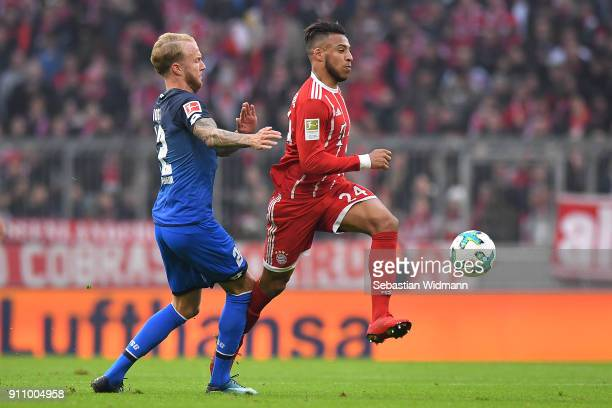 Kevin Vogt of Hoffenheim tries to stop Tolisso of Bayern Muenchen during the Bundesliga match between FC Bayern Muenchen and TSG 1899 Hoffenheim at...