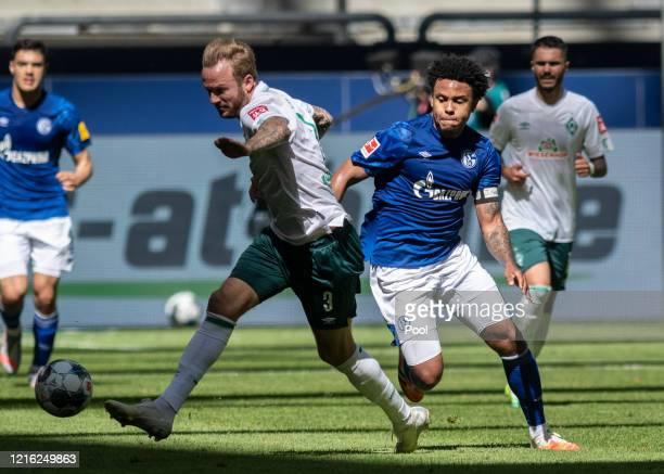 Kevin Vogt of SV Werder Bremen is challenged by Weston McKennie of FC Schalke 04 during the Bundesliga match between FC Schalke 04 and SV Werder...