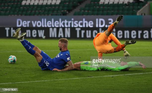Kevin Vogt of TSG 1899 Hoffenheim and Oliver Baumann of TSG 1899 Hoffenheim foul Marin Pongracic of VfL Wolfsburg during the Bundesliga match between...