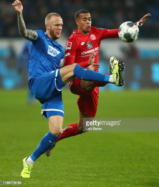 Kevin Vogt of TSG 1899 Hoffenheim battles for possession with Robin Quaison of 1. FSV Mainz 05 during the Bundesliga match between TSG 1899...