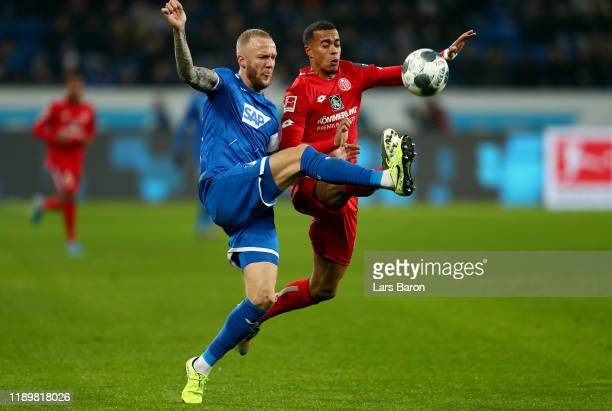 Kevin Voigt of Hoffenheim challenges Robin Quaison of Mainz during the Bundesliga match between TSG 1899 Hoffenheim and 1. FSV Mainz 05 at...