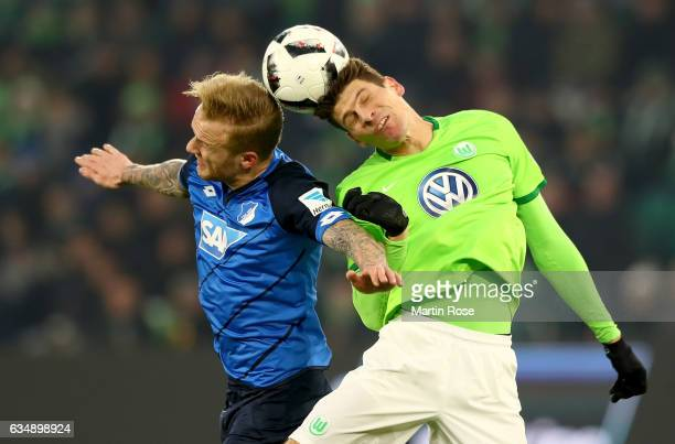 Kevin Voigt of Hoffenheim goes up for a header with Mario Gomez of Wolfsburg during the Bundesliga match between VfL Wolfsburg and TSG 1899...