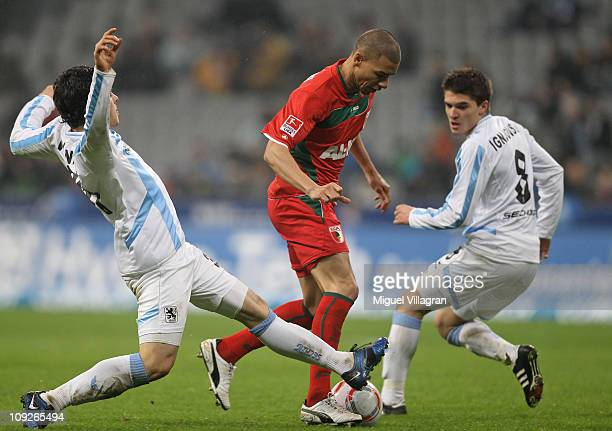 Kevin Volland and Aleksandar Ignjovski of 1860 Muenchen fight for the ball with Marcel Ndjeng of FC Augsburg during the second Bundesliga match...