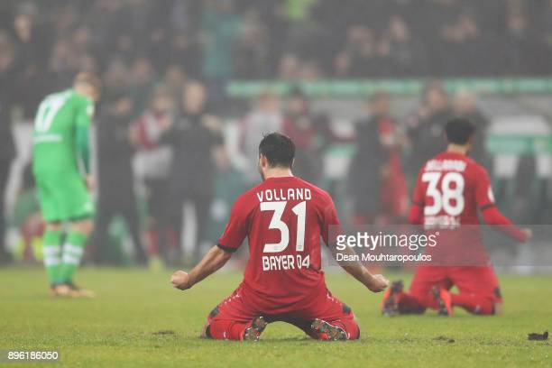 Kevin Volland and Karim Bellarabi of Bayer 04 Leverkusen celebrate victory after the DFBPokal match between Borussia Moenchengladbach and Bayer...