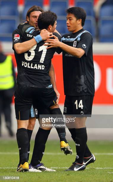 Kevin Volland celebrates the third goal with Djordje Rakic and Bobby Wood of Muenchen during the Second Bundesliga match between MSV Duisburg and TSV...