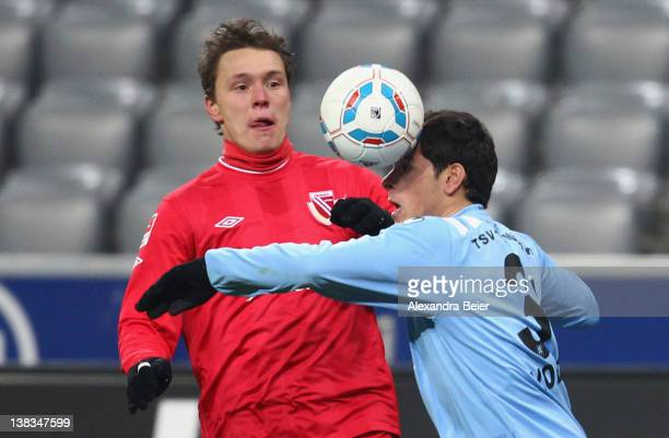 Kevin Volland of 1860 Muenchen heads the ball next to Alexander Bittroff of Energie Cottbus during the German second league match between 1860...