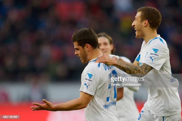 Kevin Volland of 1899 Hoffenheim celebrates with team mates after scoring his team's second goal during the Bundesliga match between Bayer Leverkusen...