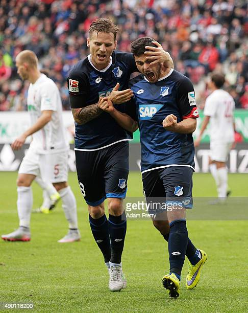 Kevin Volland of 1899 Hoffenheim is congratulated by Eugen Polanski of 1899 Hoffenheim after scoring a goal during the Bundesliga match between FC...
