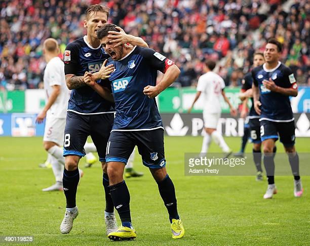 Kevin Volland of 1899 Hoffenheim is congratulated by Eugen Polanski of 1899 Hoffenheim after scoring a goal during the Bundesliga match between FC...