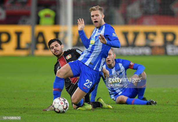 Kevin Volland of Bayer 04 Leverkusen and Arne Maier of Hertha BSC during the Bundesliga match between Bayer 04 Leverkusen and Hertha BSC at the...