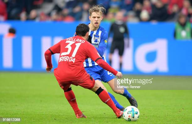 Kevin Volland of Bayer 04 Leverkusen and Arne Maier of Hertha BSC during the first Bundeliga game between Bayer 04 Leverkusen and Hertha BSC at...