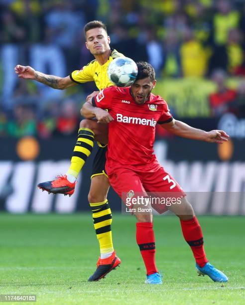 Kevin Volland of Bayer 04 Leverkusen and Julian Weigl of Borussia Dortmund battle for the ball during the Bundesliga match between Borussia Dortmund...