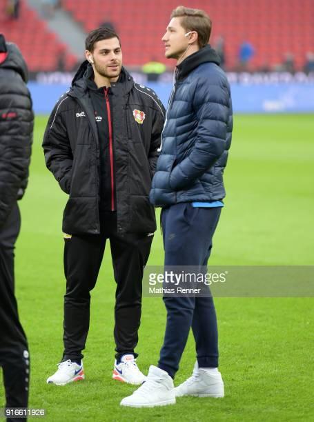 Kevin Volland of Bayer 04 Leverkusen and Niklas Stark of Hertha BSC before the first Bundeliga game between Bayer 04 Leverkusen and Hertha BSC at...
