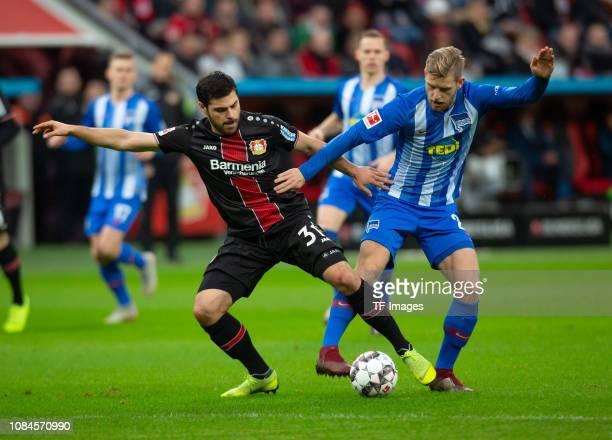 Kevin Volland of Bayer 04 Leverkusen Arne Maier of Hertha BSC Berlin battle for the ball during the Bundesliga match between Bayer 04 Leverkusen and...