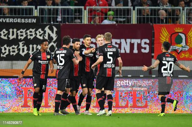 Kevin Volland of Bayer 04 Leverkusen celebrates after scoring his team's first goal with team mates during the Bundesliga match between FC Augsburg...