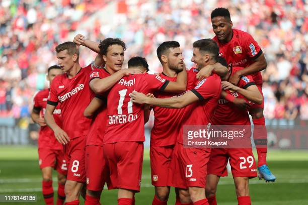 Kevin Volland of Bayer 04 Leverkusen celebrates after scoring his team's first goal with team mates during the Bundesliga match between Bayer 04...