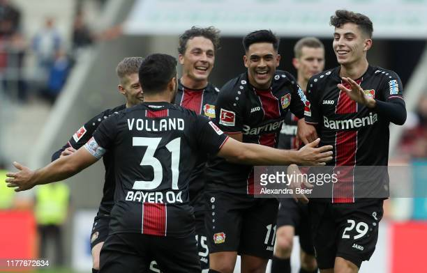 Kevin Volland of Bayer 04 Leverkusen celebrates his first goal with teammates during the Bundesliga match between FC Augsburg and Bayer 04 Leverkusen...