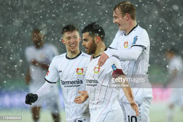 Kevin Volland of Bayer 04 Leverkusen celebrates scoring his teams first goal of the game with team mates during the Bundesliga match between Hannover...