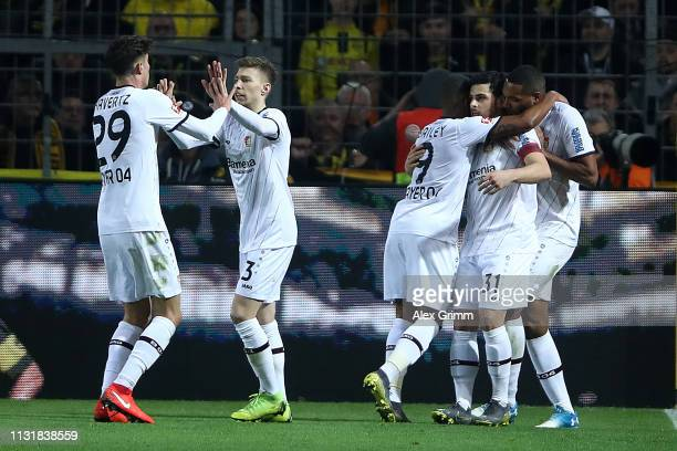 Kevin Volland of Bayer 04 Leverkusen celebrates with his team after scoring their first goal during the Bundesliga match between Borussia Dortmund...