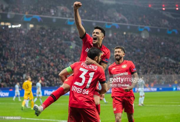 Kevin Volland of Bayer 04 Leverkusen celebrates with team mates after scoring his team's second goal during the UEFA Champions League group D match...