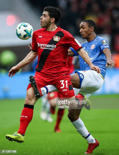 Kevin Volland of Bayer Leverkusen and Abdou Diallo of FSV Mainz 05 battle for the ball during the Bundesliga match between Bayer 04 Leverkusen and 1...