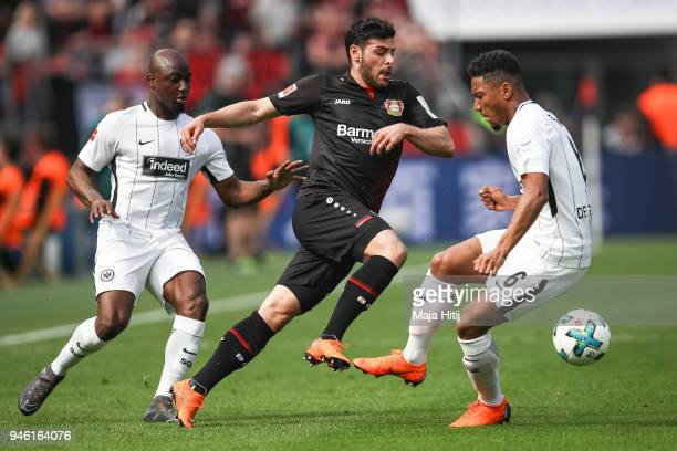 Kevin Volland of Bayer Leverkusen battle for the ball with Jetro Willems of Eintracht Frankfurtand Jonathan de Guzman of Eintracht Frankfurt the...